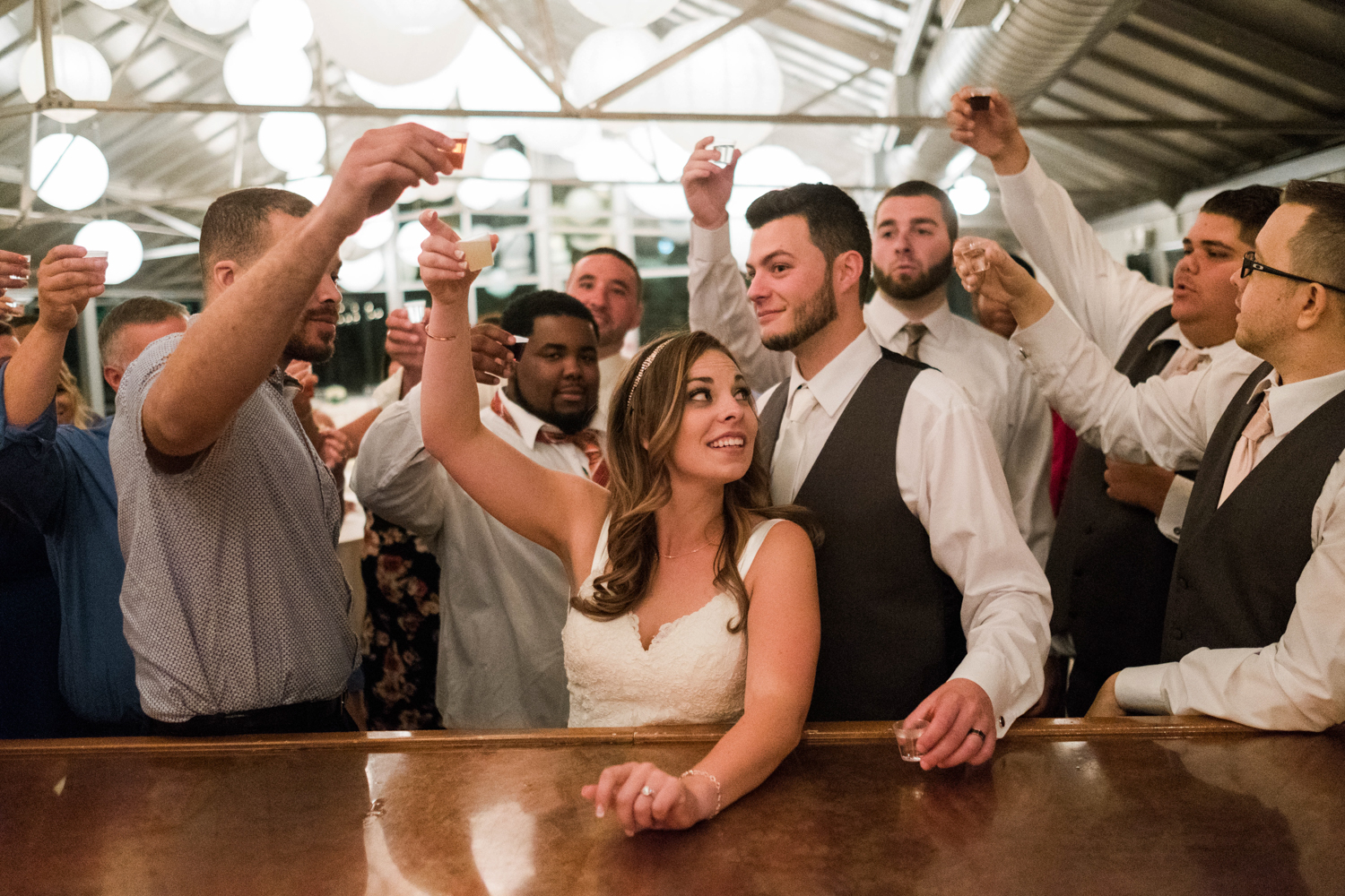 Honorable Mention 2 |Cassandra & Josh | Farmington Gardens  Fuji XT2 | 16 f1.4  I happened to walk out of the ballroom into the bar area at the perfect moment to grab this photo. Thanks to the bartenders at Farmington Gardens for giving me the chance to capture this awesome moment.
