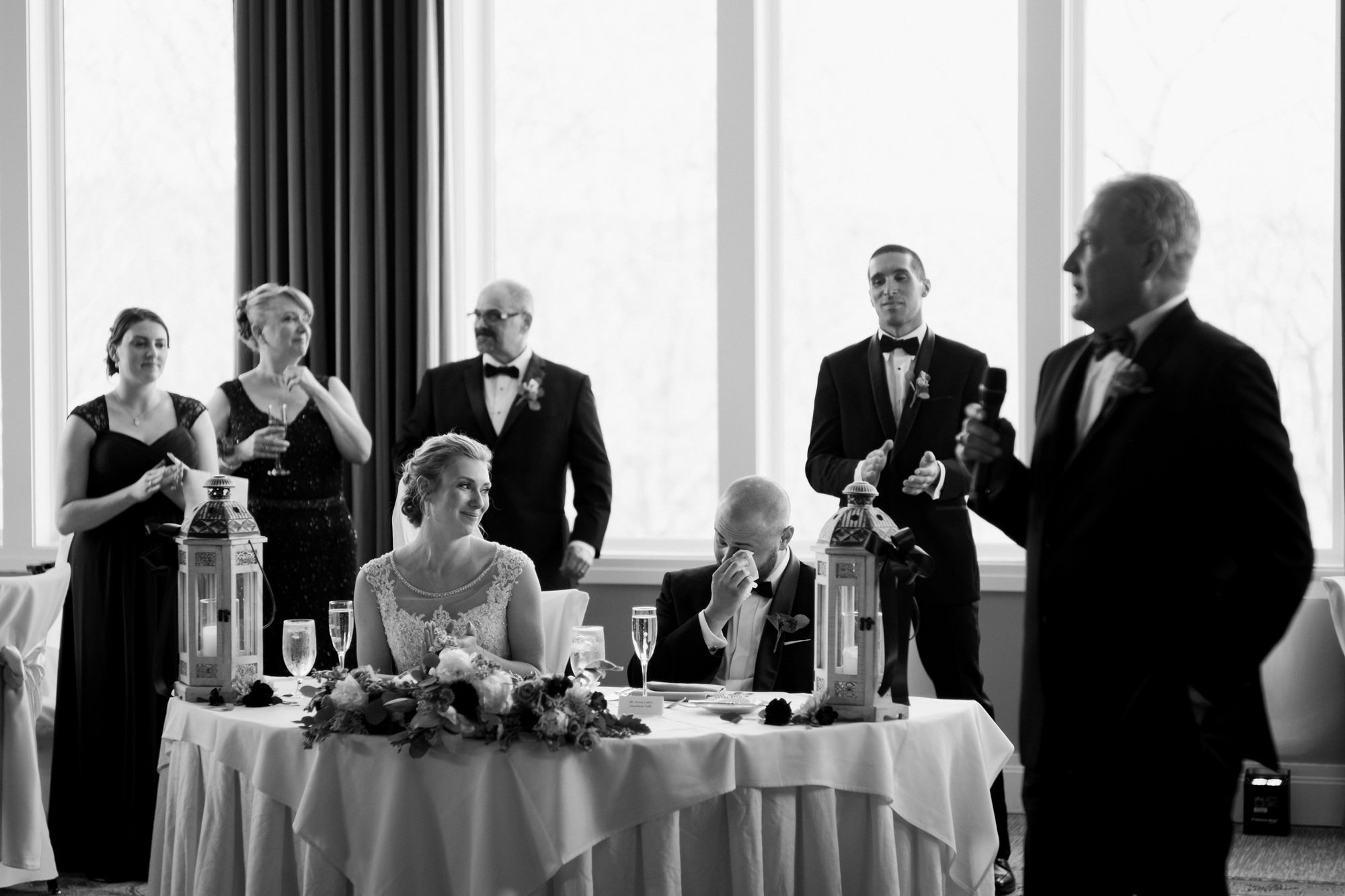 2018 Number 10 | Stephanie & Steve | Lake of Isles  Sony a9 | 85 f1.8  During an emotional toast by Stephanie's father, Steve broke down (along with many other people in the room). I dont' deliver many black and white photos in my collections, but in this case the faces of the people were too important, and the coloring of the image took away from that. A great toast, great photo, and great way to start this year's top 10.