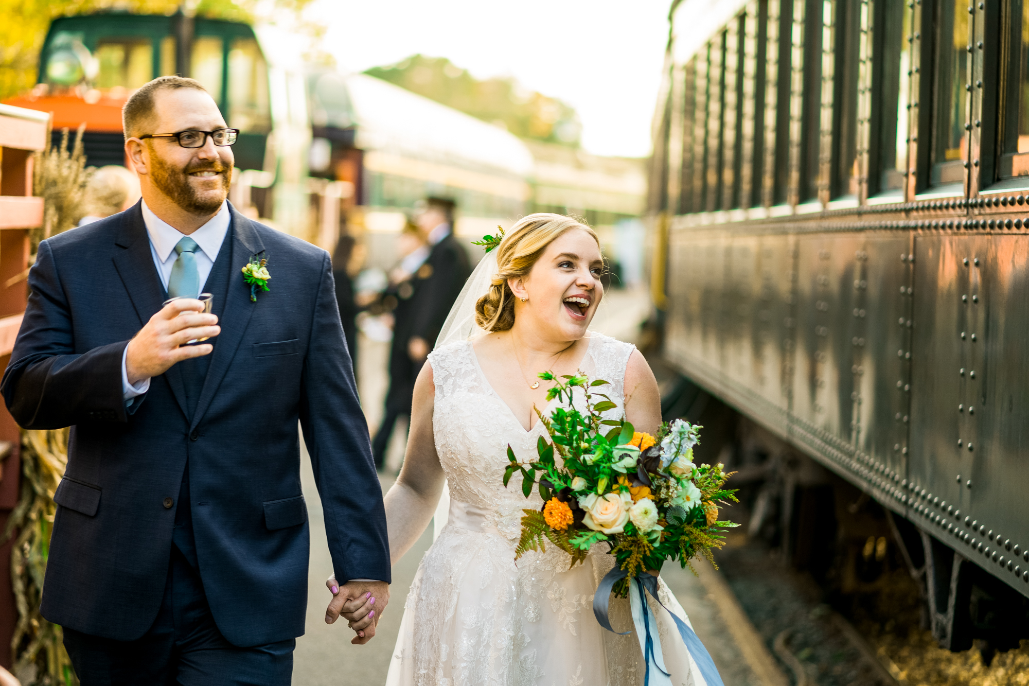2018 Number 7 | Alex & Pat | Essex Steam Train & The Lace Factory  Sony a9 | 85 f1.8  As a young couple, Alex and Pat have been through alot. Perhaps, more hardship than most ever will. But here they are, on their wedding day, about to board a steam train, drinks and flowers in hand, with 200 of the most important people in their lives cheering them on. No couple of mine could understand more the importance of finding small moments of joy in life, and immersing yourself in them. It was an honor to photograph this wedding.