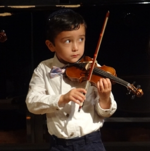 My son Nathan on his tiny violin!