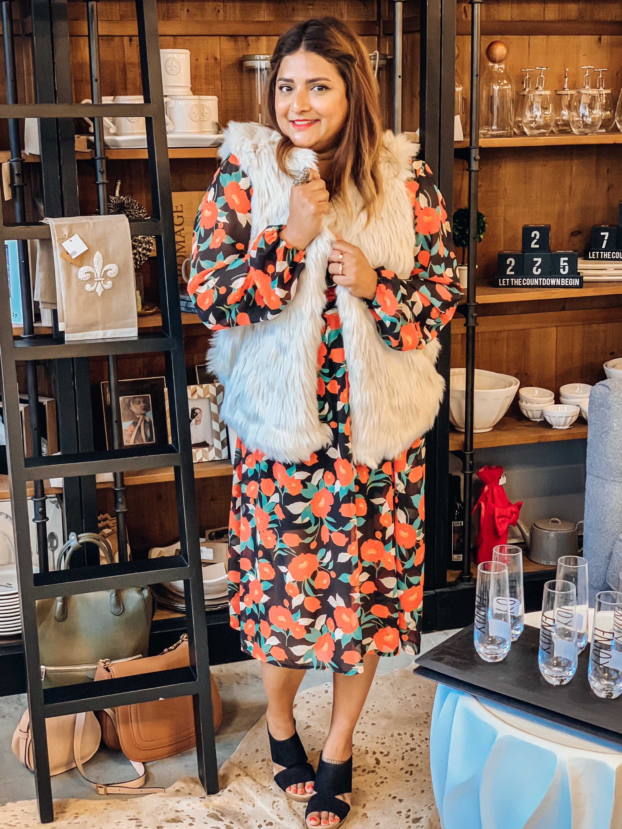 As night time temperatures start to drop, I love dark florals paired with faux fur vests for a cozy look. This vest is Dylan Los Angeles, available at Laura of Pembroke at Pinecrest. As of this writing, this vest retails for $155