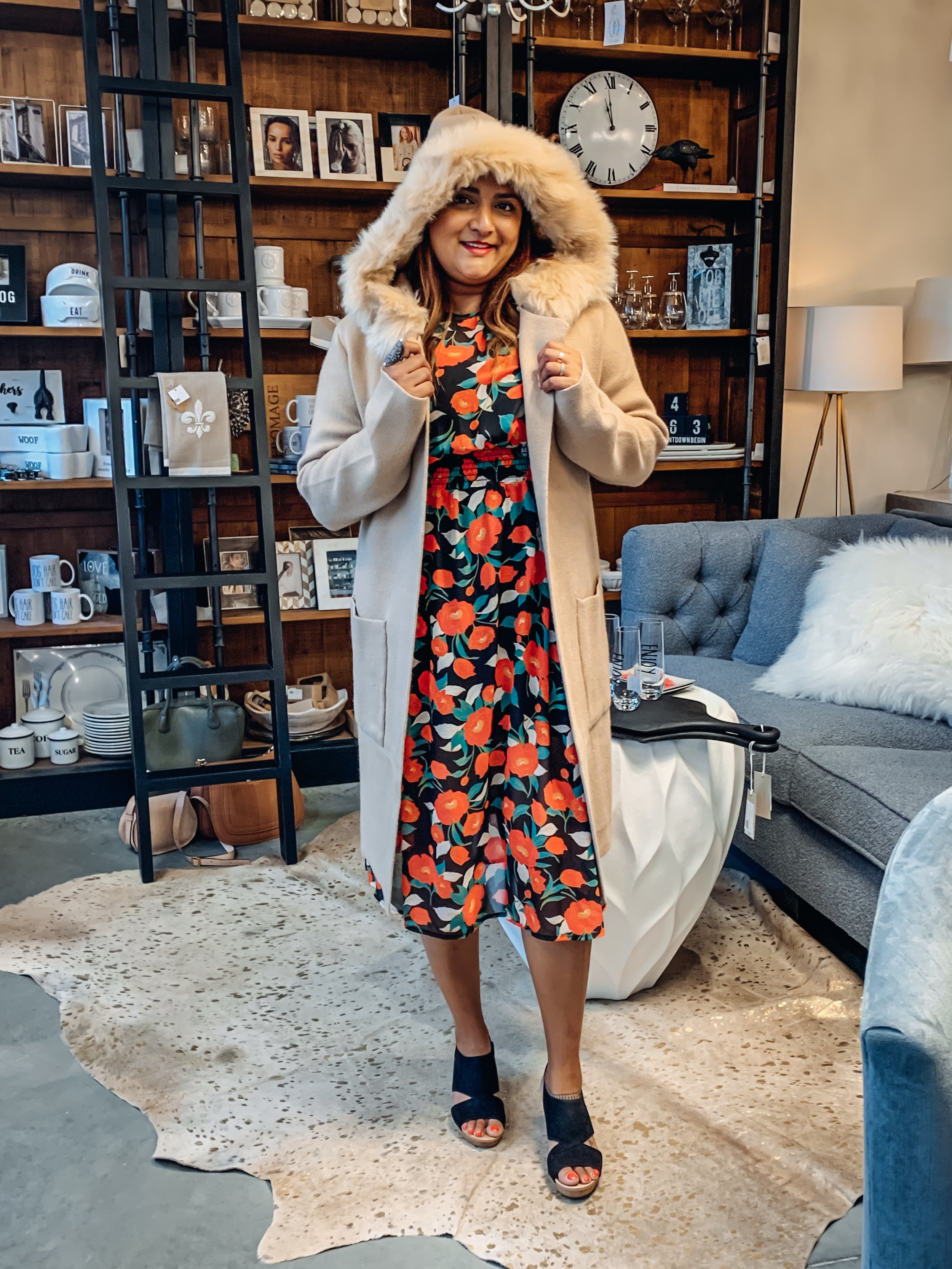 Although I hate to admit it, it's going to get a lot colder soon, and when it's too cold for a vest, I love the look of sweater coat. This one with a faux fur hood is by Love Token, available at Laura of Pembroke and retails at $166 as of this writing.