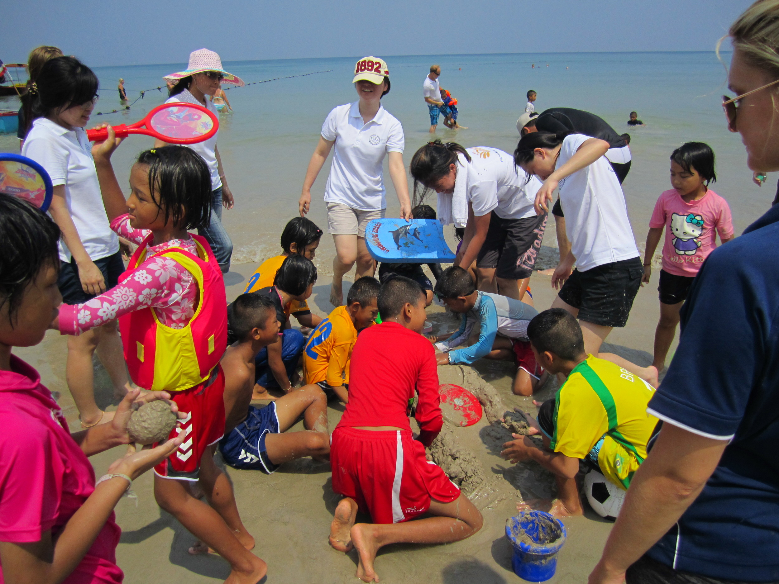Enjoying time at the beach with the children of the Coconut Club after-school and residential program in Phuket, Thailand