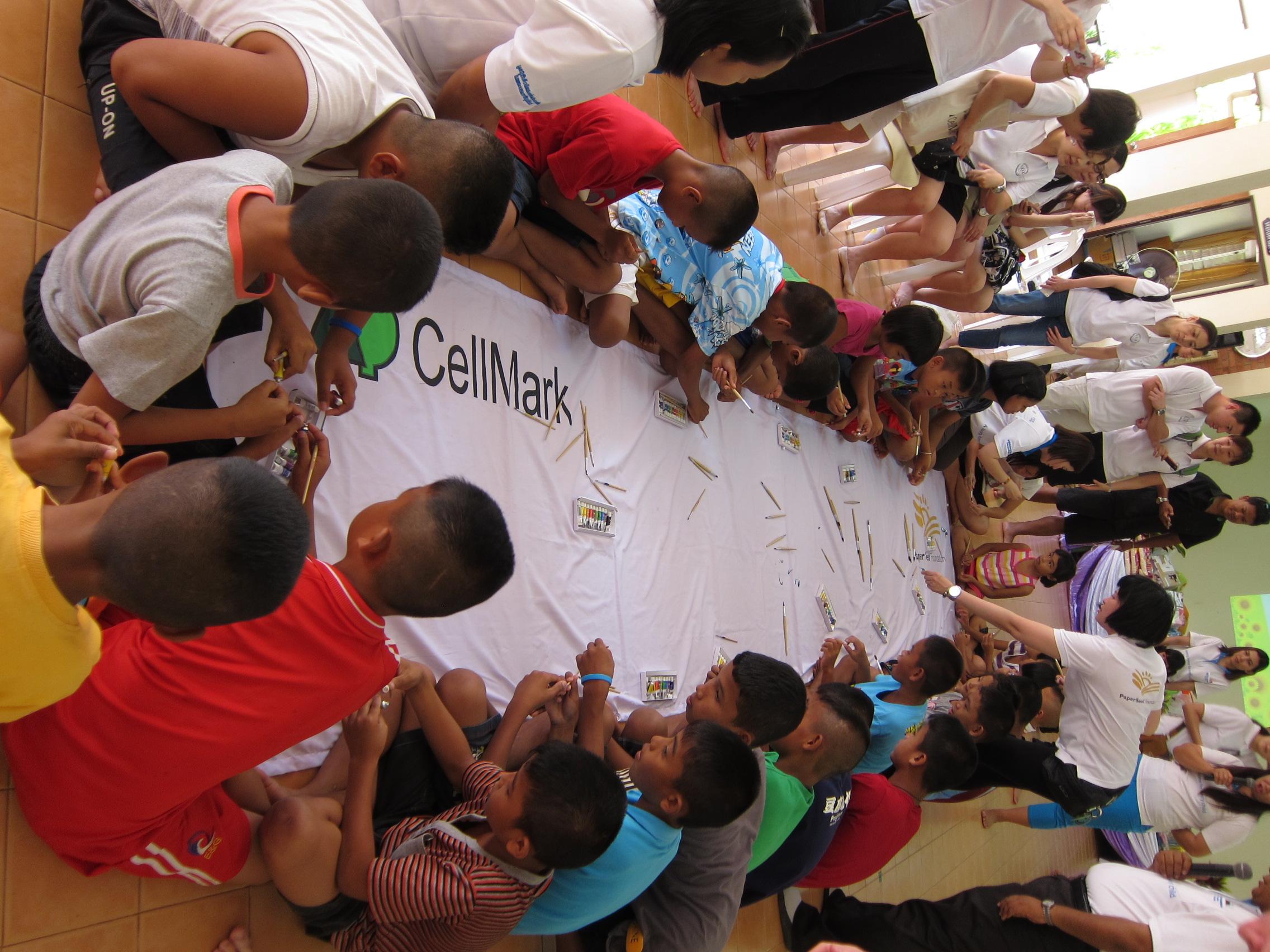 Creating artwork with the children of SOS Children's Village and Phuket Sunshine Village orphanages in Phuket, Thailand