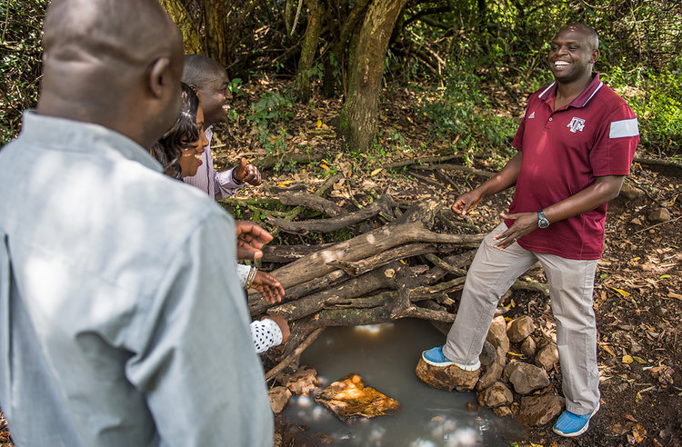 TKP Executive Director stands over the tree farm's freshwater stream