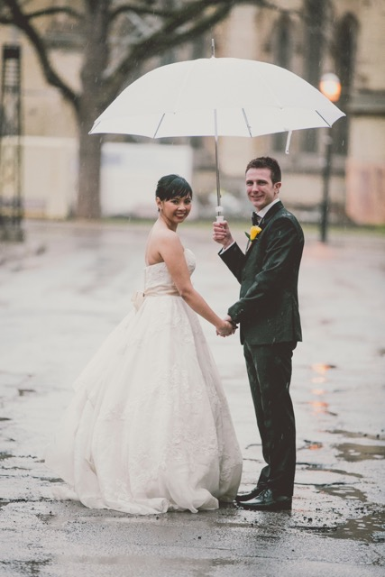Usually couples don't plan for rain, but it sure makes for great photos! Credit:  Olive Studio