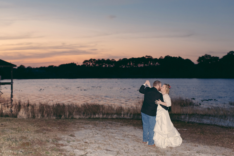 Outdoor Southern Wedding | bride and groom dancing by the lake