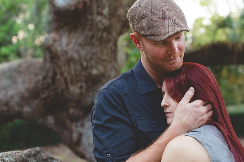 Outdoor Orlando Engagement Session   Couple cuddling
