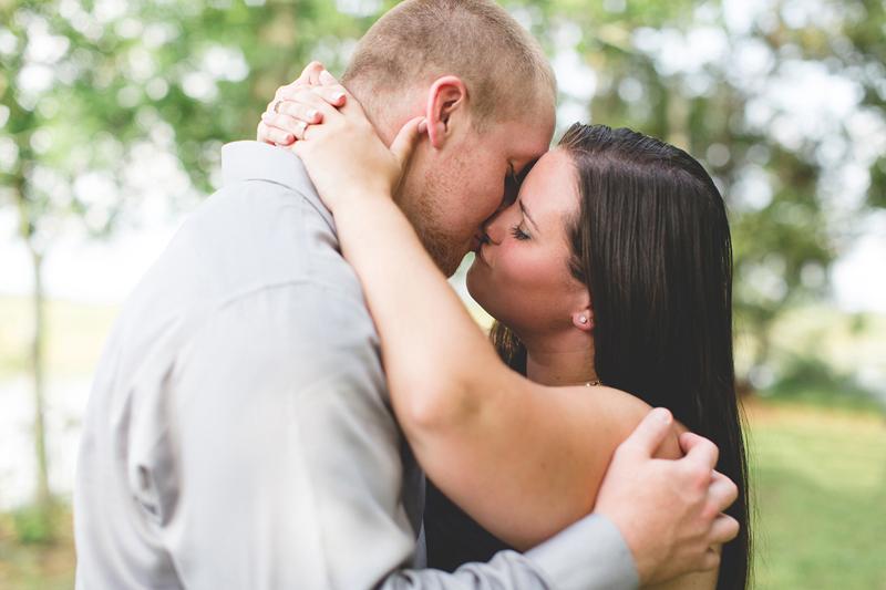 lake parker park engagement photos couple kissing lakeland wedding photographer