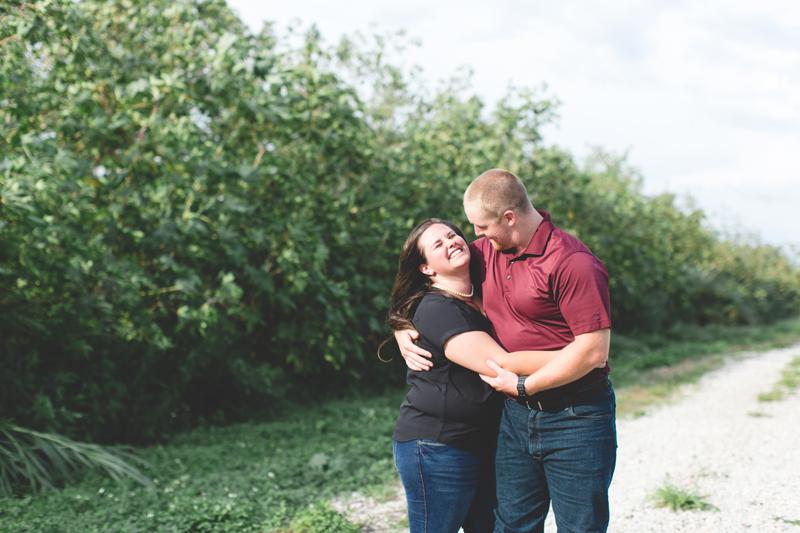 couple laughing walking together outside lakeland lake parker park engagement photo lakeland wedding photographer
