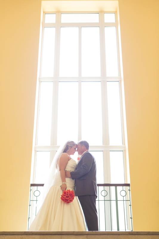 orange county regional history center intimate wedding bride and groom portrait in window