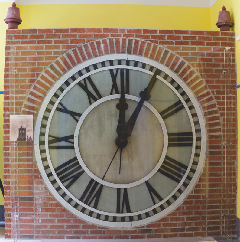 orange county regional history center intimate wedding huge clock inside of museum