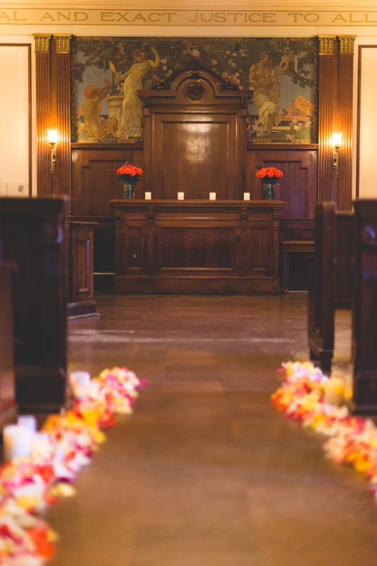 orange county regional history center intimate wedding inside of old courtroom flowers down aisle