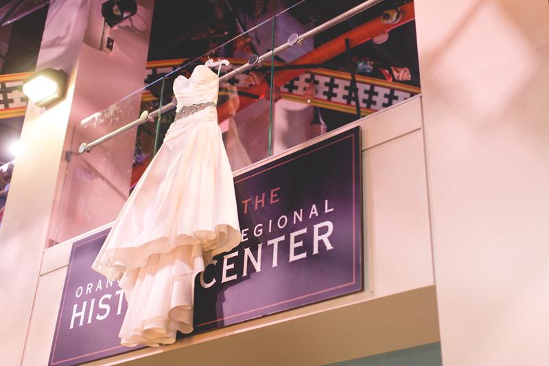 orange county regional history center intimate wedding wedding dress stillife hanging from 2nd story of museum