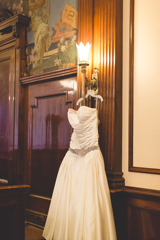 orange county regional history center intimate wedding stillife wedding dress in old courtroom