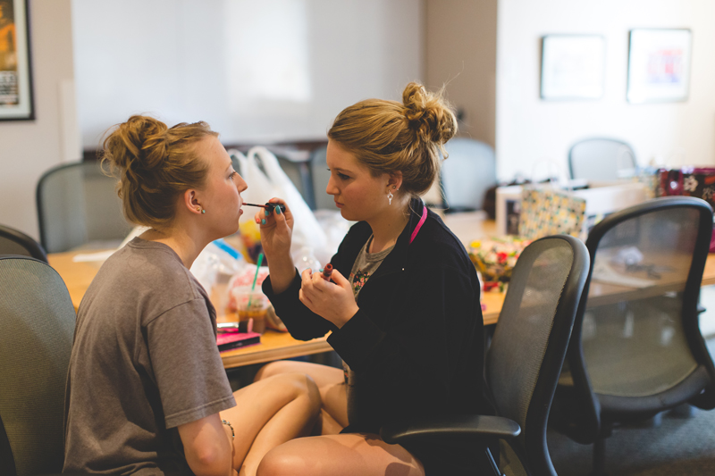 orange county regional history center intimate wedding bridesmaids putting on makeup before wedding