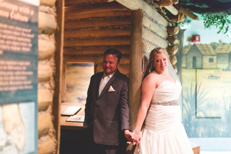 orange county regional history center intimate wedding bride and groom first touch holding hands with eyes closed