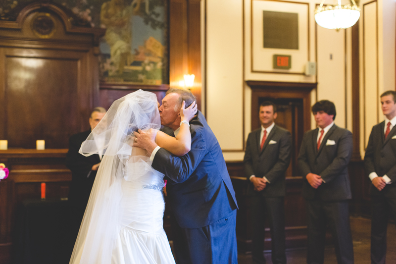 orange county regional history center intimate wedding father of the bride kissing bride during ceremony