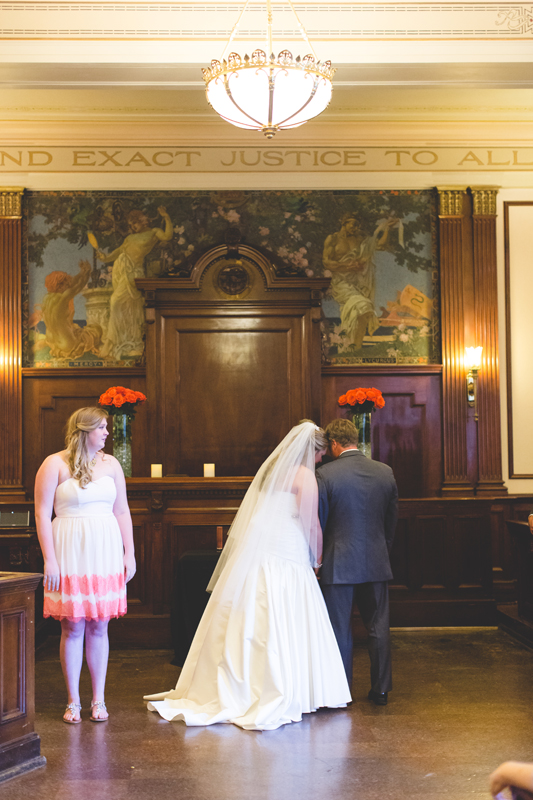 orange county regional history center intimate wedding bride and groom listening to bridesmaid sing during ceremony