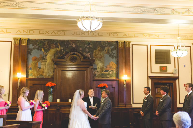 orange county regional history center intimate wedding bride and groom ceremony inside of old courtroom