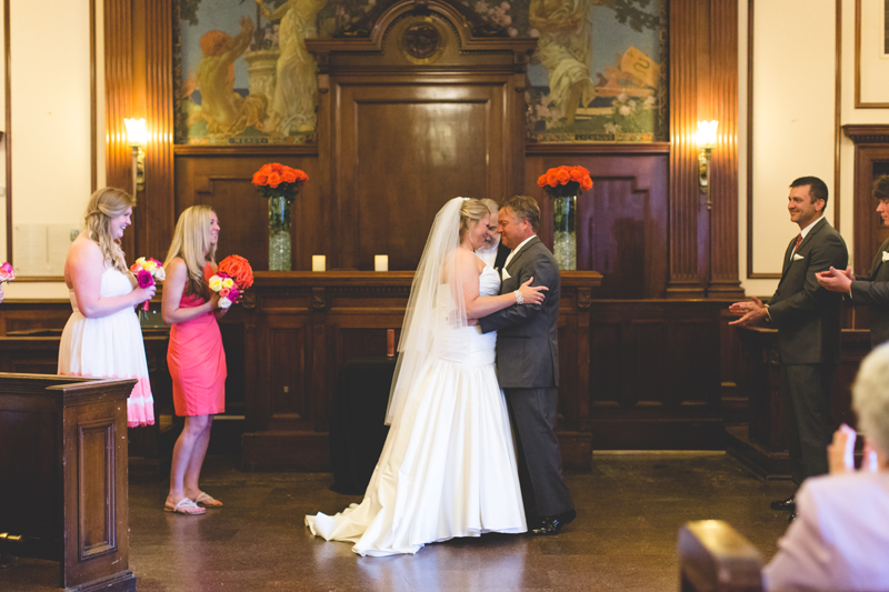 orange county regional history center intimate wedding bride and groom getting married in old courtroom