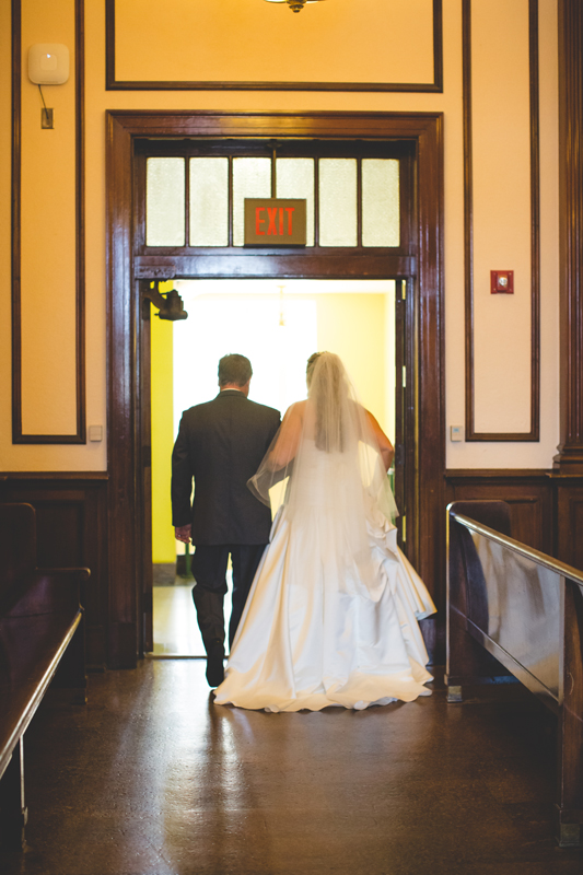 orange county regional history center intimate wedding bride and groom exit ceremony in old courtroom