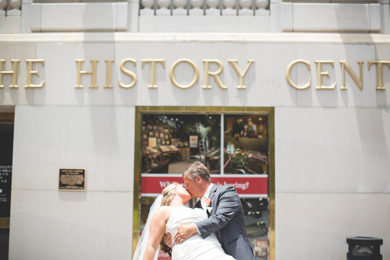 orange county regional history center intimate wedding groom dipping bride outside of museum