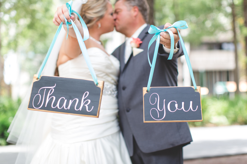 orange county regional history center intimate wedding bride and groom holding thank you sign