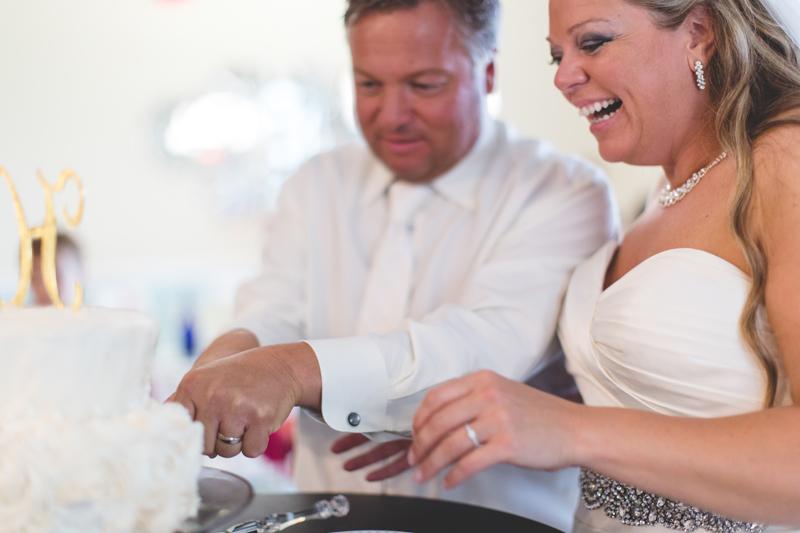 orange county regional history center intimate wedding bride and groom cutting cake