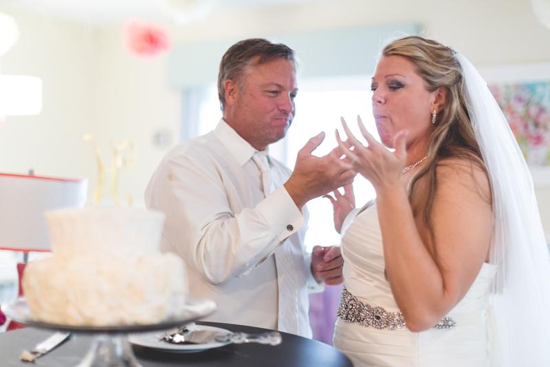 orange county regional history center intimate wedding groom feeding bride wedding cake
