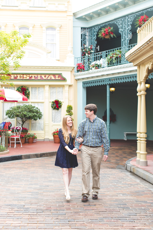 disney magic kingdom engagement session photos couple walking