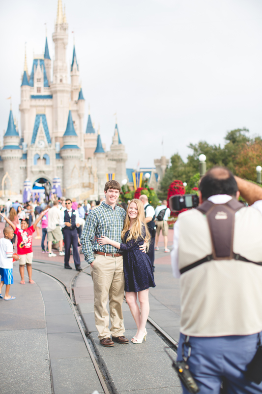 Disney Magic Kingdom engagement session photo couple hugging on main street