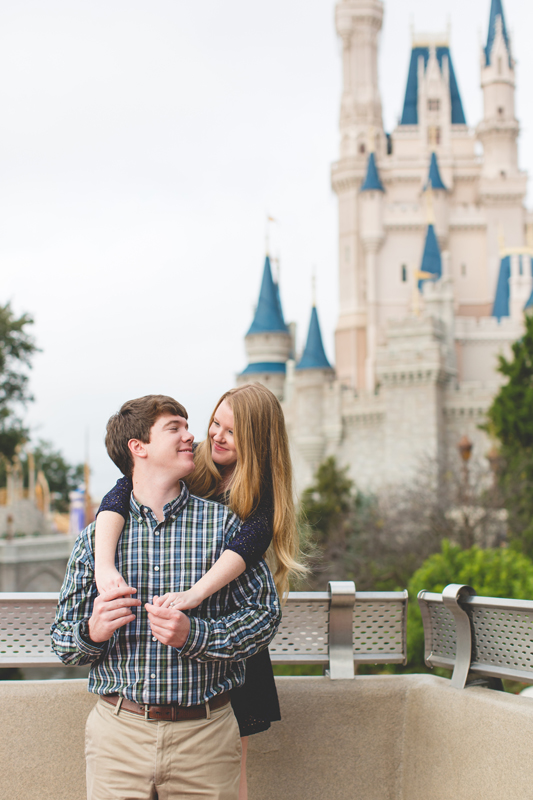 Disney Magic Kingdom Engagement session couple in front of castle