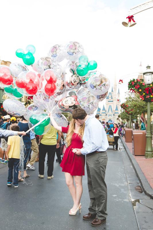 Disney Magic Kingdom Engagement photos couple holding Disney balloons on main street