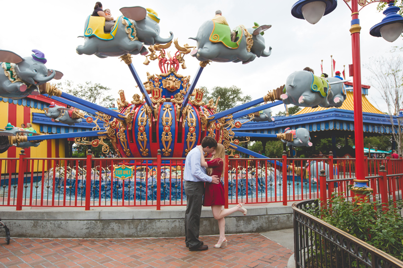 Disney Magic Kingdom Engagement Session Photos dumbo ride couple kissing
