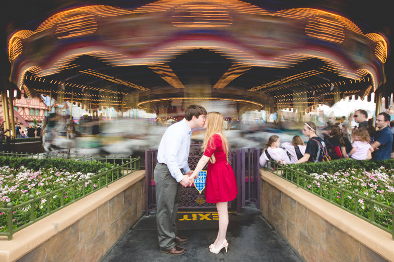 Disney Magic Kingdom Engagement Session Photos couple kissing in front of carousel
