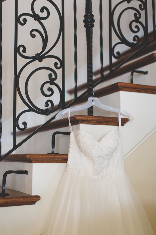 intimate wedding in a house - wedding dress on staircase