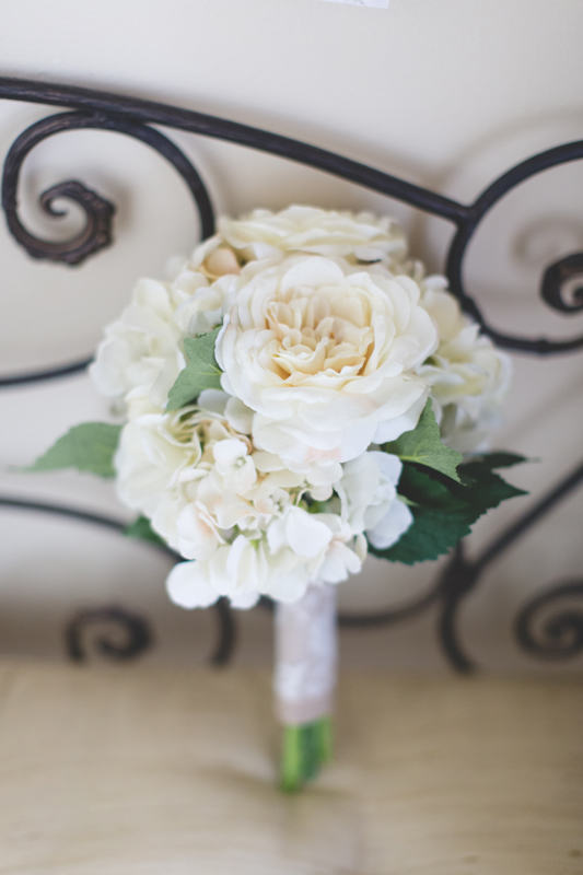 intimate wedding in a house - bride bouquet on stairs
