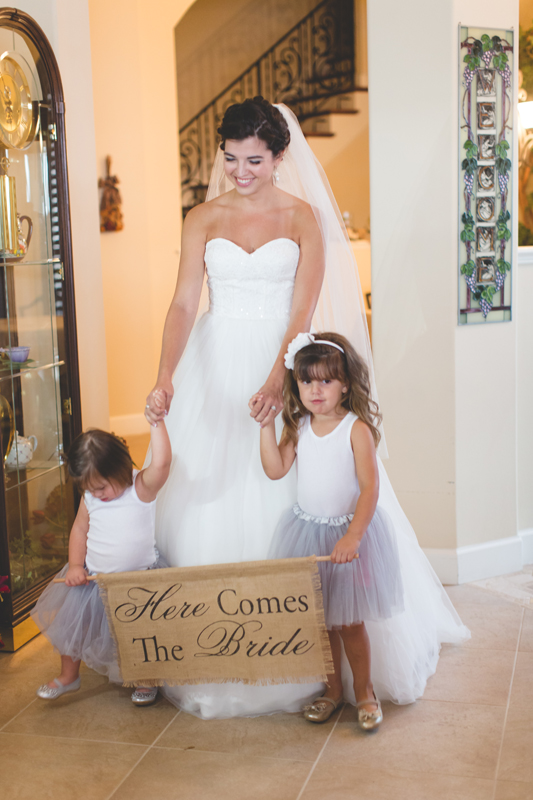 jaime diorio destination orlando wedding photographer bride flower girls here comes the bride sign ceremony photo