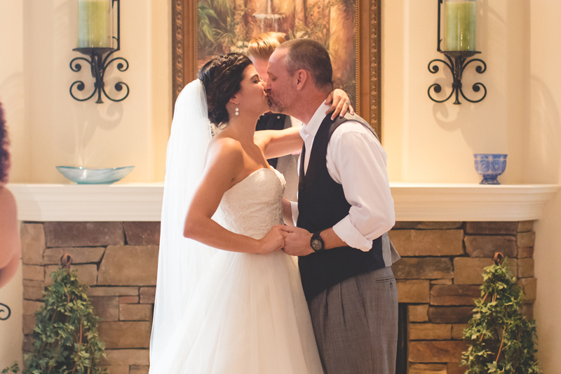 jaime diorio destination orlando wedding photographer first kiss bride and groom