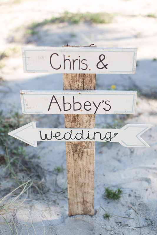 Wedding sign on beach - Beach Wedding Photos - destination Orlando wedding photographer - Jaime DiOrio