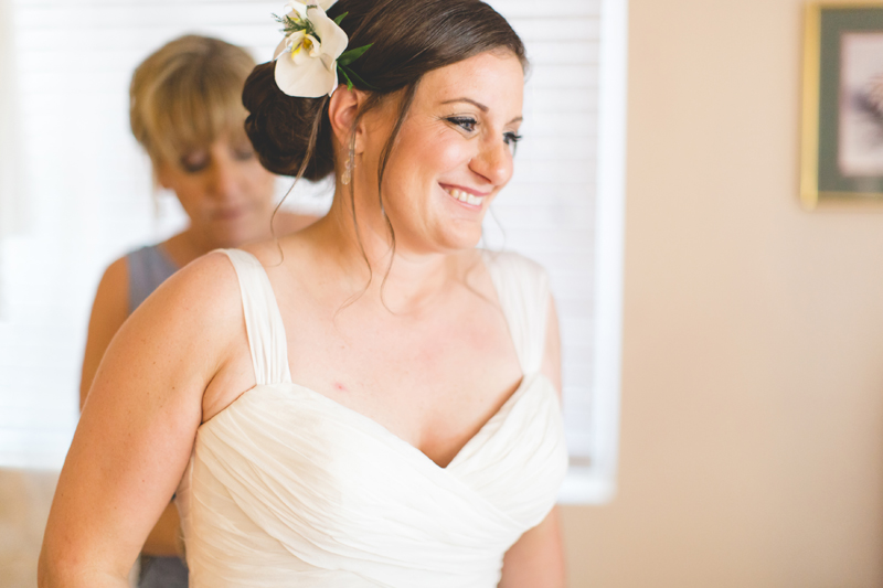 Bride smiling in wedding dress - Beach Wedding Photos - destination Orlando wedding photographer - Jaime DiOrio