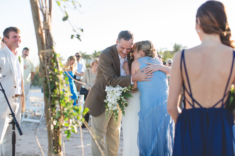 Mother and Father of Bride hugging her - Beach Wedding Photos - destination Orlando wedding photographer - Jaime DiOrio