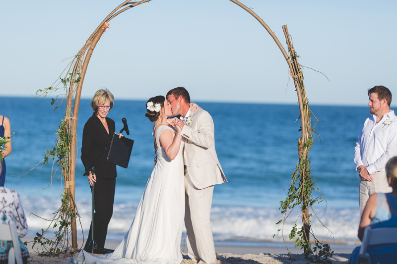 Bride and Groom first kiss - Beach Wedding Photos - destination Orlando wedding photographer - Jaime DiOrio