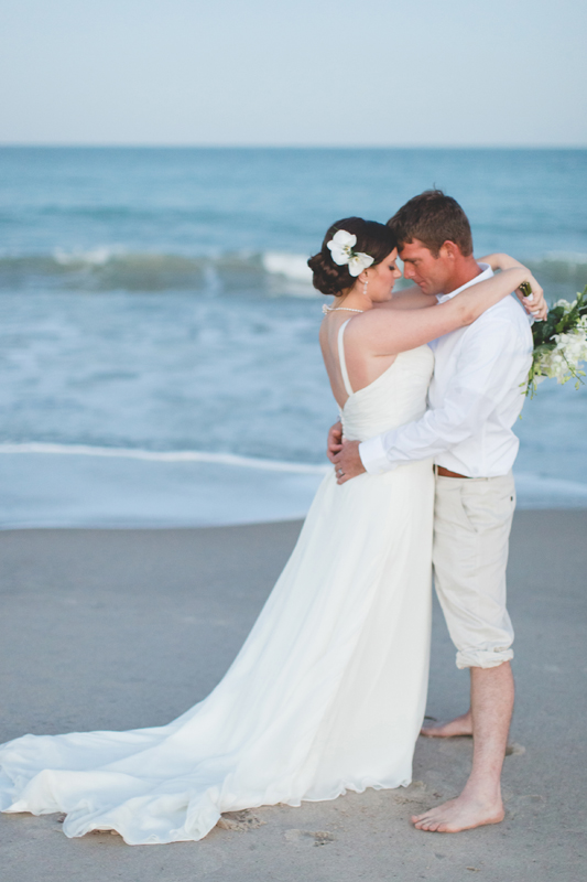 Bride and Groom hugging on beach - Beach Wedding Photos - destination Orlando wedding photographer - Jaime DiOrio