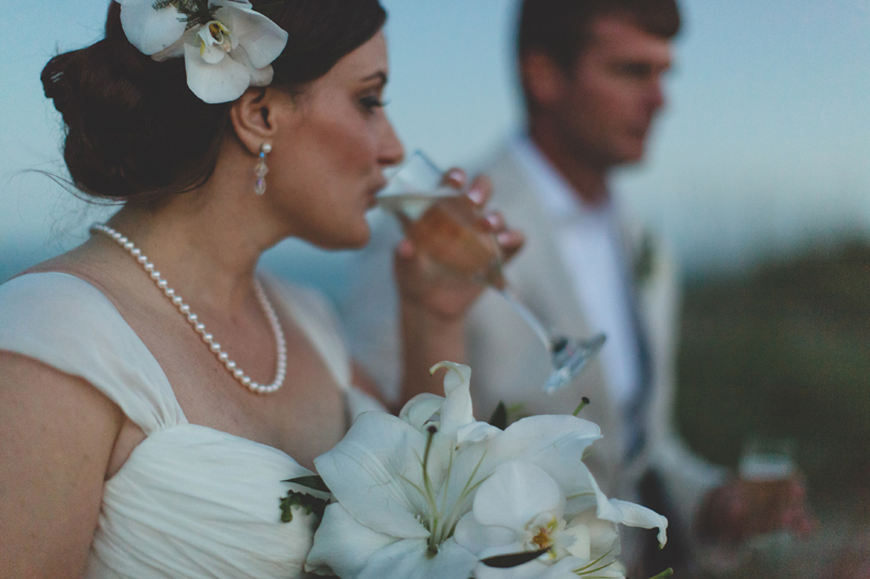 Bride and Groom drinking champagne - Beach Wedding Photos - destination Orlando wedding photographer - Jaime DiOrio