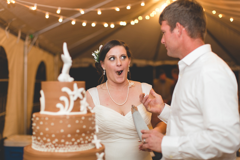 Bride and Groom cutting wedding cake - Beach Wedding Photos - destination Orlando wedding photographer - Jaime DiOrio