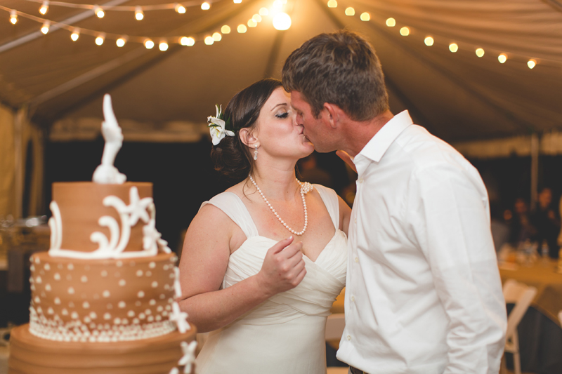 Bride and Groom kissing at cake cutting - Beach Wedding Photos - destination Orlando wedding photographer - Jaime DiOrio
