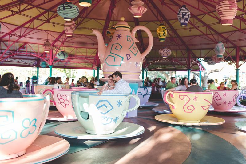 couple laughing on tea cup ride - Jaime DiOrio Disney Photographer-Magic Kingdom photo shoot-Disney family session - family photos.jpg