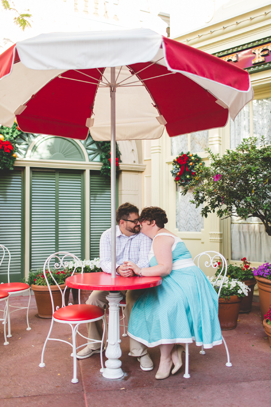 fun Disney photo session - Jaime DiOrio Disney Photographer-Magic Kingdom photo shoot-Disney family session - family photos - umbrella table.jpg